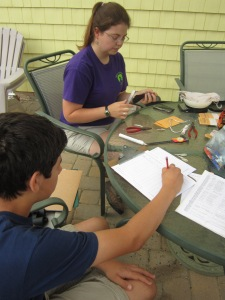 Aidan records measurements of a gray catbird for  Evangeline. June 2014