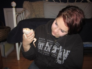 "Jade gets ""Norbert"", a bearded dragon, used to being held."
